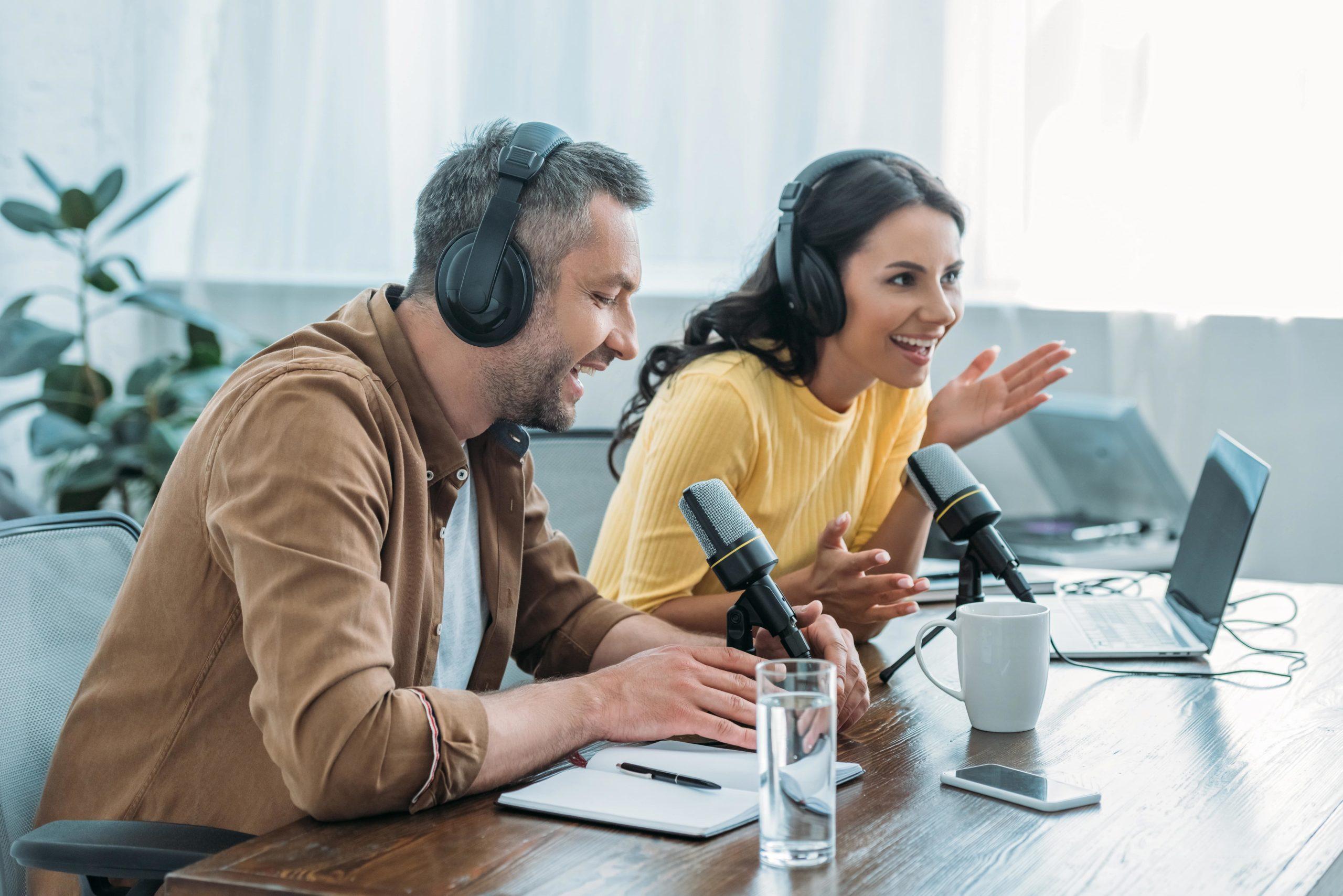 https://technoedgelearning.ca/wp-content/uploads/2021/10/two-cheerful-radio-hosts-in-headphones-recording-p-2021-09-01-14-40-25-utc-min-scaled.jpg